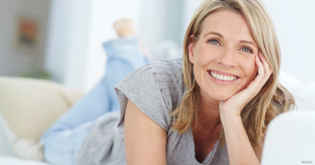 A woman in Sacramento, CA is happy that tummy tuck surgery was able to treat her belly pooch.